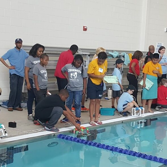 STEAMsport, Inc. students putting their ROV in the water 2
